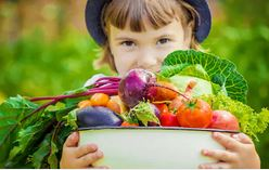 child with veg bowl